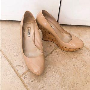 Cream colored Miu Miu wedge shoes